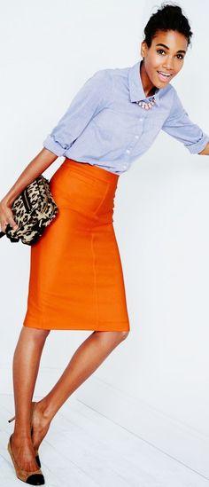 blue shirt, orange skirt, leopard clutch
