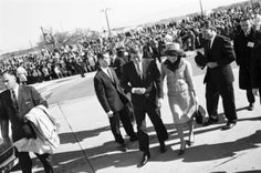 Pres. and Mrs. John F. Kennedy hand-in-hand leaving Carswell AFB for Dallas, 11/22/1963