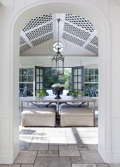 Insulate a veranda for year-round use. Lattice ceiling and heated stone floor. Designer: Daniel Brisset