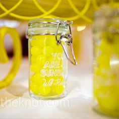 Lemon Candy Favors   The couple raided every Cost Plus World Market store in the Atlanta area for their mini-glass favor jars. They filled them with Lemonheads and personalized them with their wedding signature.