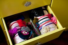 easy, stylish DIY to organize your little one's hair accessories. For the bathroom cabinet drawer!