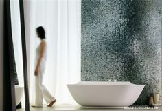 """Glass mosaics make your bathroom wall shine. The Vetro Metalli collection by Casamood offers a rich variety of colors and schemes - here in the Chromium inspired finish called """"Cromo"""" which is a greenish glass mosaic."""