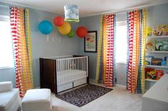 Love this grey nursery with the pops of primary color