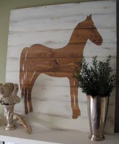 DIY art using wood paneling, stain, contact paper, and paint