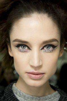 Chanel...cat eye, glitter on the lower lids