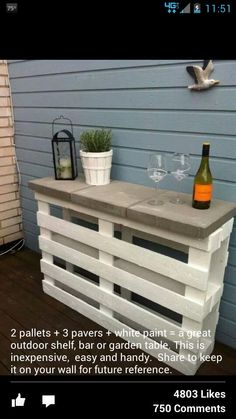 Two pallets, three pavers and white paint. Love this!