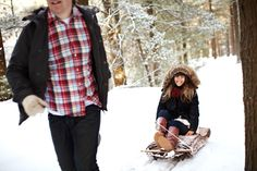 dashing through the snow! family photos in winter with sled