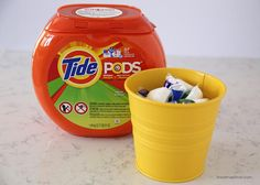 Spring cleaning tips + a free printable on iheartnaptime.com ...These IKEA containers make a great storage space for the Tide PODS! Dress up your laundry room. ;)