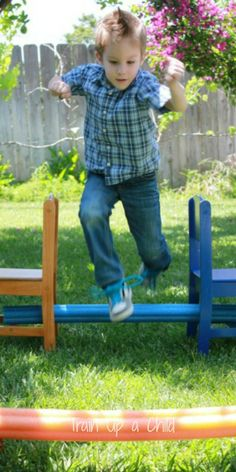 Pool noodle hurdles and other ideas for playing with pool noodles.  Simple ideas for increasing gross motor skills while having FUN.