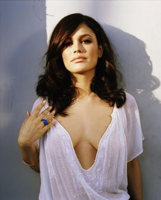 Rachel Bilson in a loose fitting and plunging white top