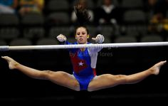 Alaina Johnson of Texas East on uneven bards in action at the American Airlines Center - 2009 Visa Championship:  Women's Competition (Aug. 12th - 15th)  WAG, women's artistic gymnastics, gymnast, photography athletics athlete (Photo: Advanced Images of Texas) @Kythoni #KyFun texa