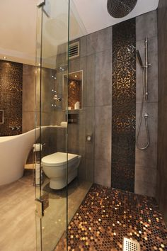 copper penny round mosaic tiles in the shower... large format, stained inspired concrete/travertine tile