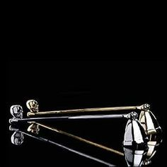 D. & L. Gold Skull Candle Snuffer