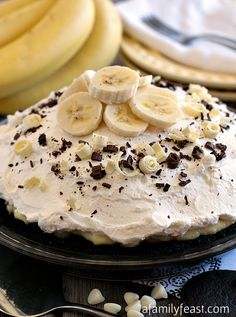 White Chocolate Banana Cream Pie - One of the best pies I've ever had! Layer upon layer of dark chocolate crumbs, banana slices, white chocolate custard and whipped cream make this one AMAZING pie recipe! PLUS - links to 25 more delicious pies from your favorite bloggers!