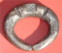 "SUKHOTHAI KINGDOM, 1238-1438AD, 8B SILVER BRACELET COIN  Age          -   SUKHOTHAI KINGDOM, 1238-1438 AD  Weight     -   Siamese 8 TICAL or 8 BAHT  (120.8 grams)   Size          -   2"" in diameter            Details  -Has 3 stamps of flowers    Bankok"