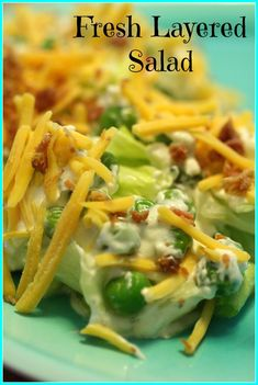 This Fresh Layered Salad has a great combination of lettuce, peas, broccoli, and a ranch based dressing. Great for a get together, potluck, or football party!