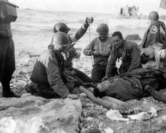 Wounded soldiers of the 16th Infantry Regiment/1st Infantry Division on Omaha, 6 June 1944