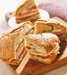 The deli meats and cheeses that go into this jumbo sandwich sometimes vary, but it's generally made in a round loaf, dressed with an olive relish, and cut into wedges to serve.