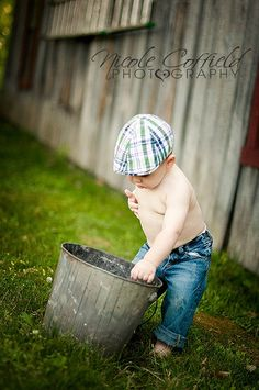 toddler boy photography - old metal bucket and barn, I love jeans and shirtless for baby boys:)
