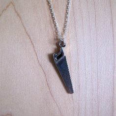 Saw Charm Necklace now featured on Fab.