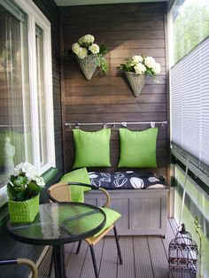 "Loving black and green these days.  Neat use of the rail to hold the storage box/bench ""back"" in place.  nice, comfy little space."