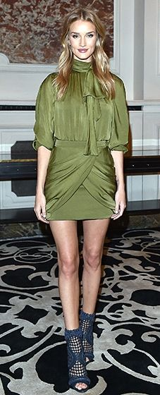Rosie Huntington-Whiteley partied the night away in an eye-catching olive green dress featuring draping detailing. She completed the look with caged blue sandals.