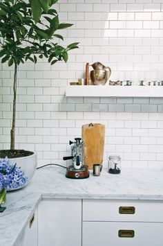 Marble countertops, white cabinets, subway tiles