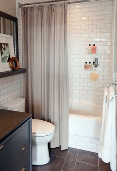 Small Bathroom Decorating Pictures with White Wall Tile // note white subway tile used in tub and around room, note picture shelf, note use of chrome baskets in shower