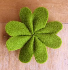 shamrock barrette - You can use scraps of felt for this simple St. Patrick's Day wearable. hand sewn, clovers, felt crafts, four leaf clover, pet, paper, st patricks day, bows, boutonnieres
