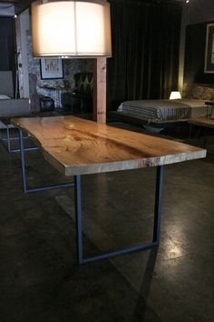 Live edge reclaimed wood table with metal legs