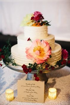 Beautiful flower covered cake: http://www.stylemepretty.com/little-black-book-blog/2014/10/20/romantic-fearrington-village-barn-wedding/ | Photography: Perry Vaile - http://perryvaileblog.com/