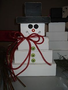 Wooden Snowman decorative holiday display made from scrap 2x4's and 4x4's.