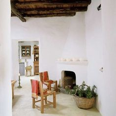 ibiza, wooden chairs, wicker baskets, houses, exposed beams, sitting rooms, corner fireplaces, vintage furniture, spanish style