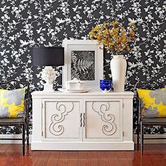console with silver nailhead detail & graphic black + white wallpaper