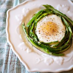 shaved asparagus with egg in the middle