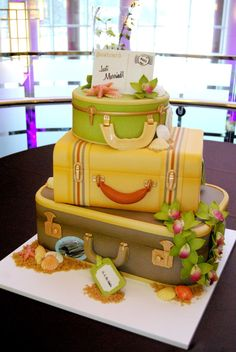 Gateaux's cake ...suit case wedding cake...love it! Great for a Sanibel Wedding Get Away!