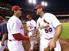 starting pitcher Adam Wainwright is congratulated by Cardinals manager Mike Matheny after pitching a 1 hit complete game shutout against the Dbacks. Cards won 5-0.  5-20-14