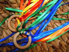 DIY rainbow ribbon streamers (party favor?) -- could use metal rings or shower curtain rings as well