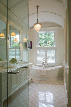 Stunning bathroom with herringbone/chevron floor tiles. #bathroom #sydney