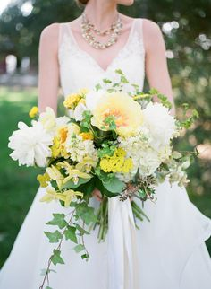 stunning yellow and white bouquet featuring peonies, hydrangeas, roses and orchids by Anna LePley Taylor