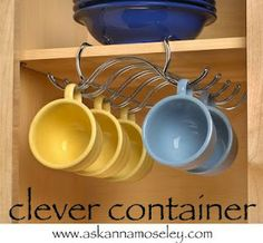 Great way to organize coffee cups and create extra space in the cabinet! #organize