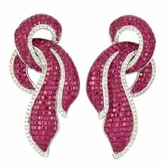 White Gold, Invisibly-Set Ruby and Diamond Earrings . 18 kt., square-cut rubies ap. 30.00 cts., round diamonds ap. 2.40 cts., with concealed pendant hooks, ap. 26.4 dwts. (Via Doyle New York.)    Diamonds in the Library