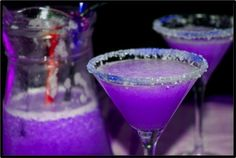 Halloween or Diva Night! Purple Martini 3 oz Vodka 1 1/2 oz cranberry juice ½ oz blue Curacao liqueur ½ oz sweet and sour mix ½ of soda 7-up Pour the ingredients into a cocktail shaker and shake gently. Add more blue Curacao if the color isn't purple enough. Serve in a chilled sugared glass.