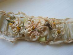 Beautiful antique ribbonwork.  Etsy.