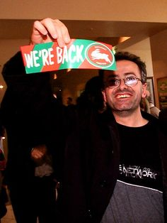 Andrew Denton celebrates following the news that the Federal Court had upheld their appeal to allow Souths to re-enter the NRL competition.