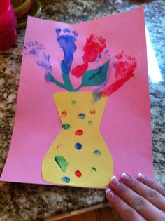 Footprint flower vase: pink, yellow, green construction paper, thumbprint to decorate vase, footprint for flowers!