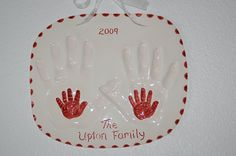 I like this one better. Parents handprints with baby's in both.