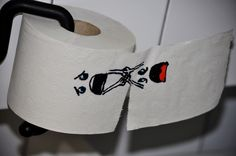 Toilet Paper Hanging On!