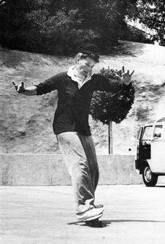 KATHERINE HEPBURN having fun riding a skateboard.