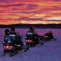 Birthday snowmobile tour across the frozen lake